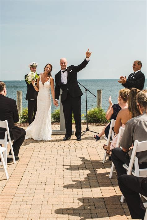 The new Mr.   Mrs. at their Michigan waterfront wedding