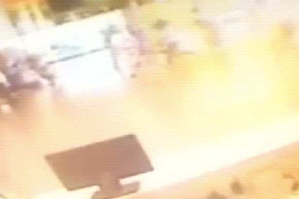 Airport CCTV images as a gunman detonates a suicide vest in the airport as people run away from him at Ataturk airport