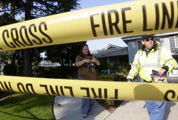 Fullerton Mayor Pro Tem Greg Sebourn tours damaged home