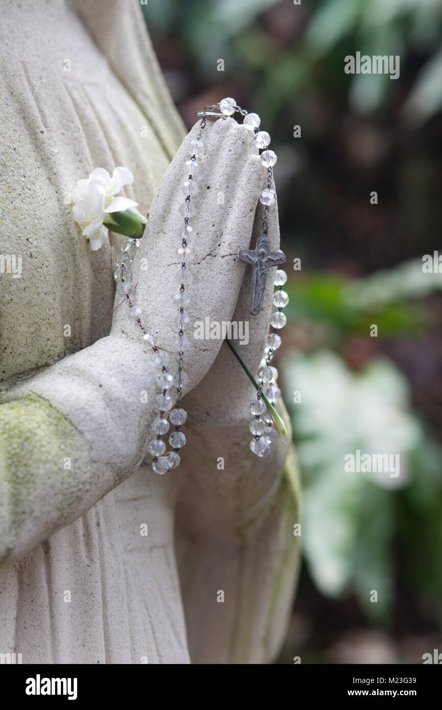 Stone Statue Praying Hands Holding Rosary Beads Stock Photo