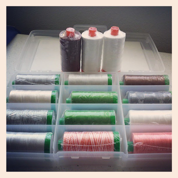 #aurifil in the house. So many praises to Follow That Thread for the amazing prices and shipping. Look I got a box to boot. PS- FtT site has an extra gem that matches kona solids with aurifil colors.