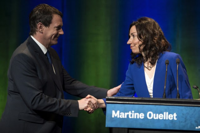 Pierre Karl Péladeau etMartine Ouellet lors d'undébat des... (PHOTO PC)