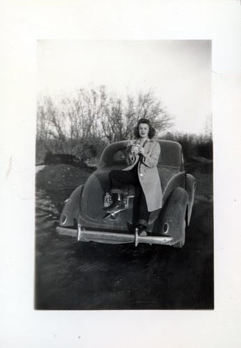 Girl on car trunk