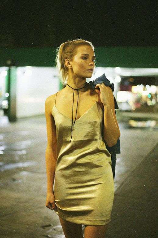Le Fashion Blog Ponytail Hair Black Tie Front Choker V Neck Nude Slip Dress Via Erin Pederson for Last Daze