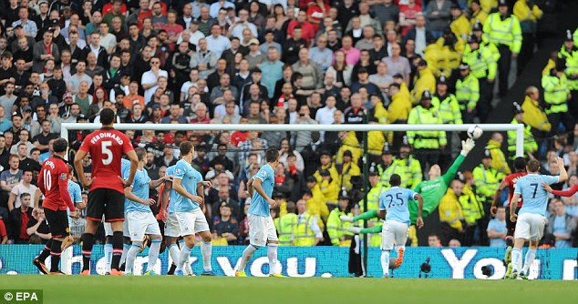 Too little too late: Rooney scores from a free kick to make the score 4-1 in the final ten minutes