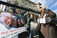 Judy Gross, wife of Alan Gross, an American imprisoned in Cuba, right, talks to Nirma Medrano, left, during a rally to support her husband, Monday, Nov. 28, 2011, outside the Cuban Interests Section in Washington. (AP Photo/Manuel Balce Ceneta)