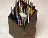 Paint brush rack holds 17 larger brushes and 32 smaller brushes. - TheIronBow