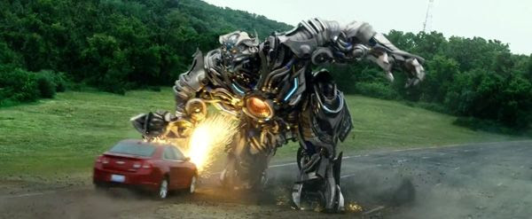 Lockdown wreaks havoc on a passing car in TRANSFORMERS: AGE OF EXTINCTION.