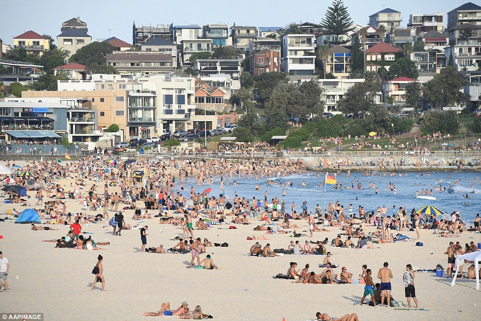 Bondi beachwas still packed well into the evening past 7pm as the weather stayed at 34C