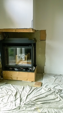 under construction, new fireplace in place