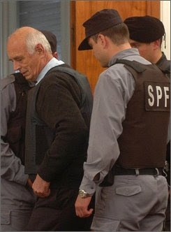 Former military chaplain Julio Von Wernich, left, arrives to a courthouse in La Plata, south of Buenos Aires, Monday, Oct. 8, 2007.  Von Wernich is the first Roman Catholic cleric to be prosecuted on charges of complicity in deaths and disappearances during Argentina's 1976-83 military dictatorship. The verdict is expected Tuesday. (AP Photo/Carlos Carmelle,Telam)
