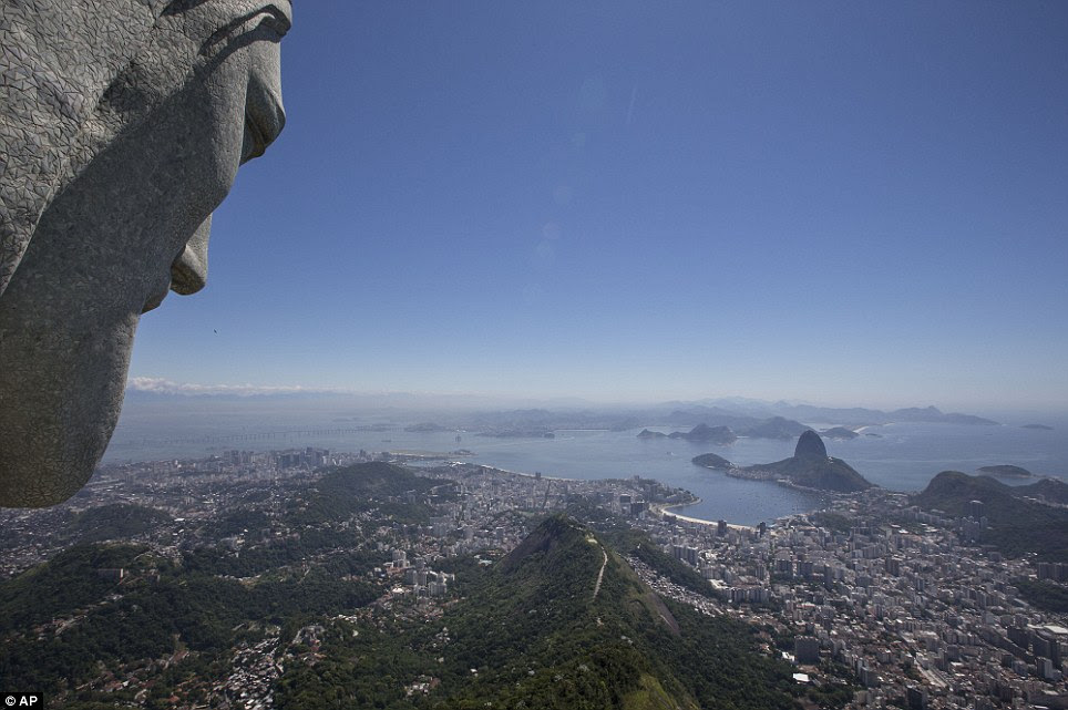 Landmark: The Christ Redeemer statue stand more than 2,000 ft above Rio on the tip of Corcovado Hill