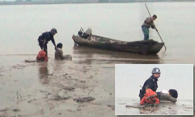 A Chinese mother tried to take her own life - and the life of her one-year-old son - by throwing herself into a river. But Huang Yuan became stuck in the mud and was rescued