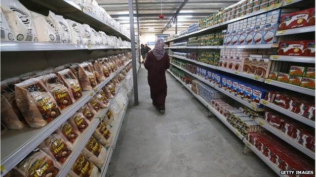 A Syrian refugee browses the aisles of the first supermarket to opened in Zaatari camp