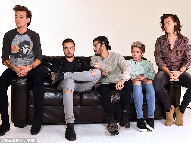 That's sick: The rest of One Direction - Louis Tomlinson, Liam Payne, Zayn Malik and Niall Horan - agreed that it was 'weird' Harry's vomit had been listed on eBay