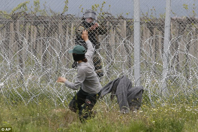 However, Macedonian police (pictured) responded by firing tear gas and stun grenades at the refugees