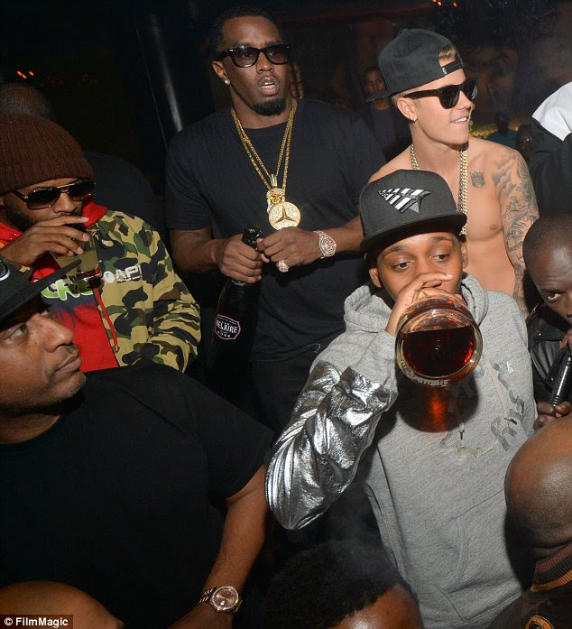 Blingin: Bieber fit right in with all the jewellery loving rappers as he showed off his two large chains