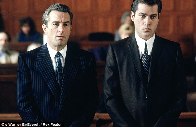In the dock: Robert De Niro, left, who played notorious mafia man James Conway in Goodfellas and Liotta as Henry Hill appear in court during the film