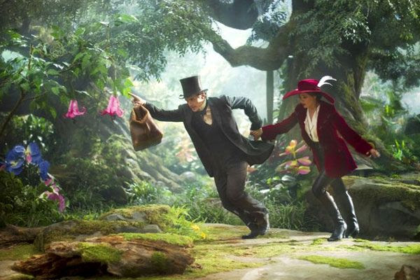 Oscar Diggs and Theodora (Mila Kunis) head to Emerald City in OZ: THE GREAT AND POWERFUL.