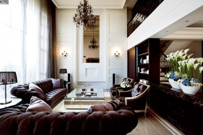 To take advantage of the dual level proportions of the lounge, a romantic wrought iron balcony overlooks the living area from the second floor.