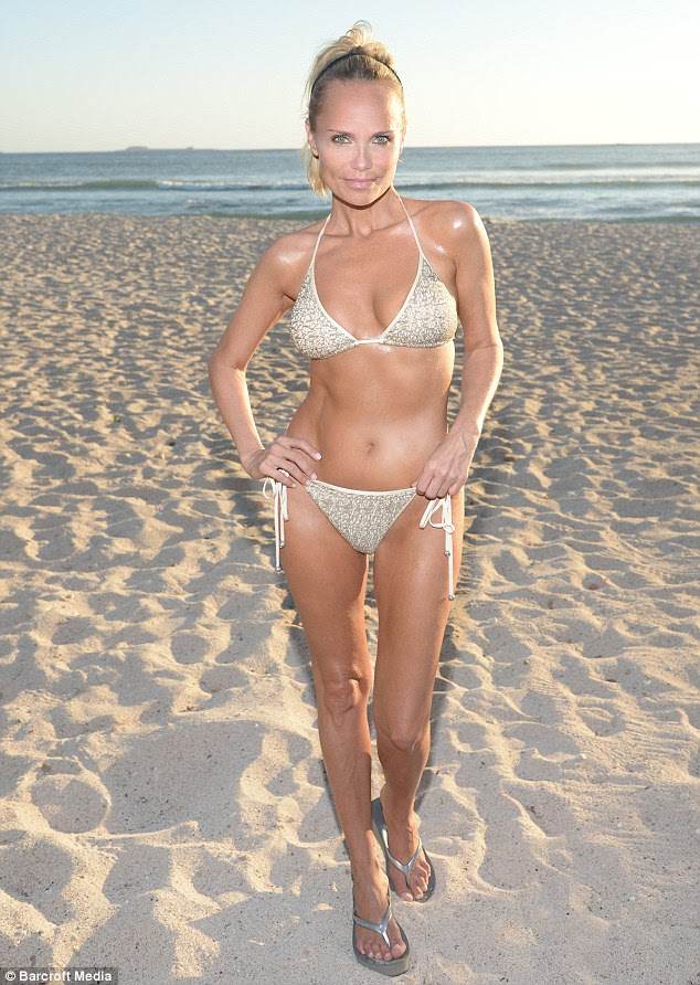 Golden girl of the beach: Kristin Chenoweth shows off her impressive bikini body in a light metallic two-piece as she laps up the rays in Mexico on Tuesday