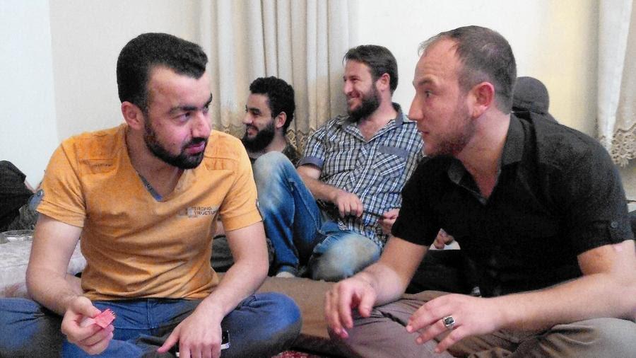 Syria rebel spokesman Abu Firas with rebel fighter