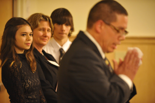 Nicole Maines (from left), 14, her mother Kelly Maines and her twin brother Jonas listen to Wayne Maines (right) as he delivers a stirring speech about their experience in helping Nicole seek justice and acceptance as a transgender youth.