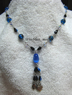 blue crystal wire wrapped into a necklace