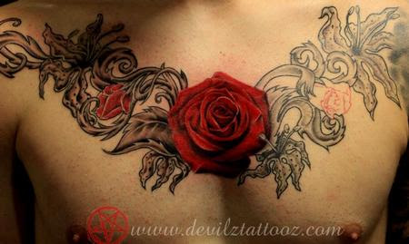 Red Rose Tattoo On Man Chest