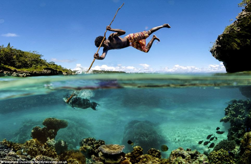 Spear fisherman Albert uses perfect precision to catch fish in this idyllic location on an island in New Caledonia