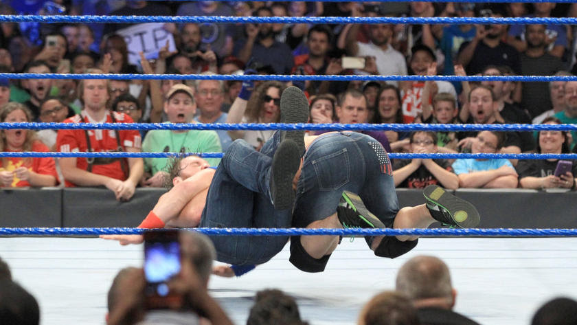 Cena and Ambrose's victory celebration is cut short when Ambrose hits his tag team partner with Dirty Deeds.