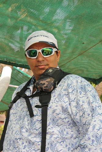 Habib Nasser Fully Equipped To Shoot The Murud Janjira Bullock Cart Race by firoze shakir photographerno1