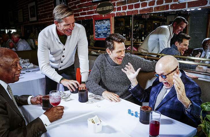 Wilkes Bashford and former San Francisco mayor, Willie Brown,  play boss dice at their table at Le Central on Monday, Oct. 5, 2015 in San Francisco, Calif.  Christian (middle left): Bruno Cucinelli sweater, $2385.  Dan (middle right): Bruno Cucinelli turtleneck $2115.  Photographer: Russell Yip Styling: Tony Bravo Model: Dan / Look Model Agency Model: Christian / Look Model Agency Hair/Makeup: Erika Taniguchi / BeautyByErika.com Photo Assistants: Stan Pechner, Danielle Mitchell Special thanks to Lorrin Mullins, Tiare Osborn, and the Wilkes Bashford staff, Paul Tanphanich and the Le Central staff, and the Honorable Willie L. Brown Jr.