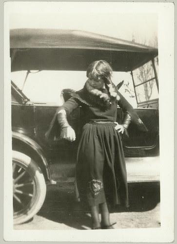 Girl, fur and car again.