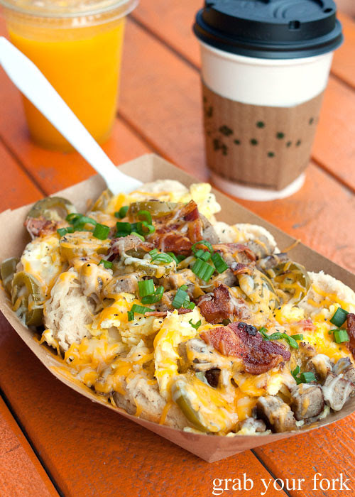 biscuits with gravy eggs cheese bacon sausage jalapeno and chives at biscuits and groovy austin texas
