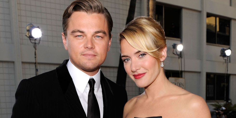 LEONARDO DICAPRIO AND KATE WINSLET ARE SITTING NEXT TO EACH OTHER AT THE SAGS