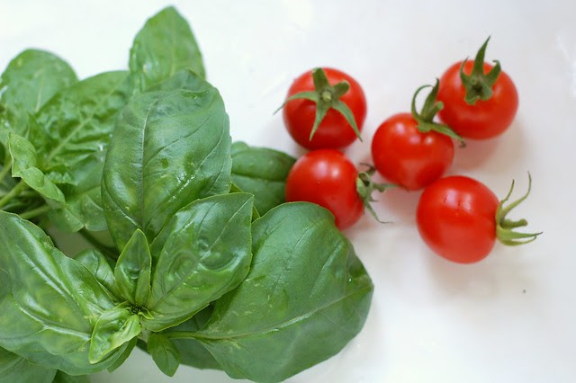 First cherry tomatoes and basil from our garden by Eve Fox, Garden of Eating blog copyright 2012