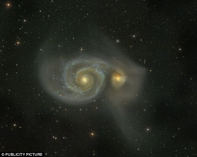 Scientists believe there may be other dwarf galaxies that have skimmed past our own. Above a spiral galaxy called M51, thought to be similar to the Milky Way, has a close encounter with another smaller galaxy