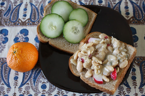 smashed white beans, cucumber and radish sandwich