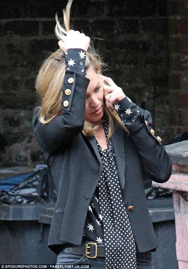 Emotional: Kate Moss was spotted chatted animatedly on the phone outside a London restaurant on Tuesday, with her wedding ring on full display amid claims her marriage to Jamie Hince is over