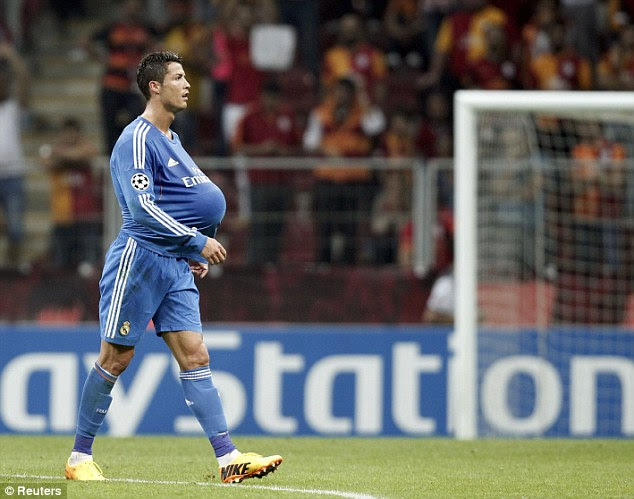 Match ball's mine: Cristiano Ronaldo put the ball inside his shirt after netting a hat-trick in Istanbul
