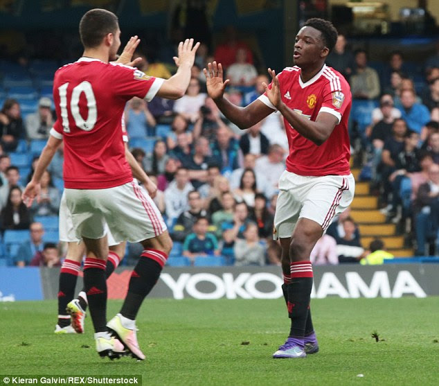 Matthew Willock celebrates scoring the winner with team-mateAndreas Pereira at Stamford Bridge