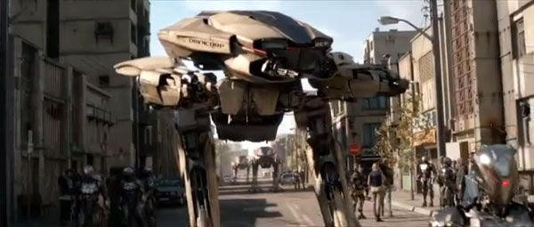 A squad of ED-209s patrols the streets with cybernetic police officers in 2014's ROBOCOP.