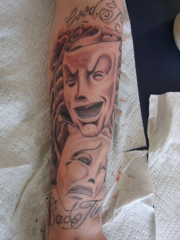 Happy And Sad Face Tattoos On Sleeve