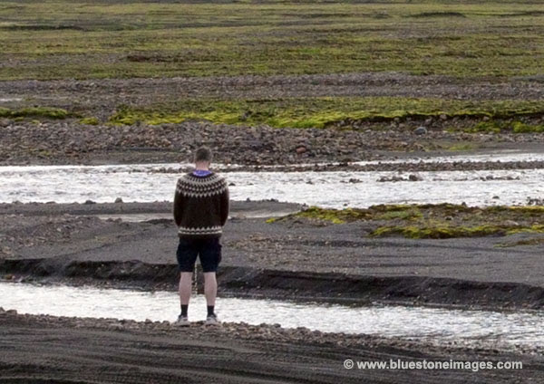 06D-0713a Temp Bloke Pissing in the Stream Next to the Hut Iceland