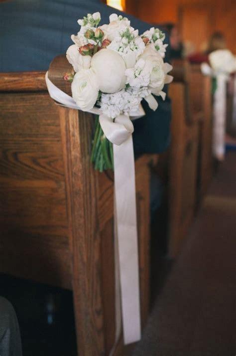 white flower arrangements for weddings church aisle