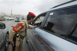 A military police trooper checks a car at a checkpoint in Sanaa August 6, 2013. REUTERS/Khaled Abdullah
