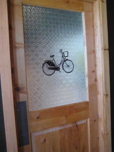 bike on women's bathroom door