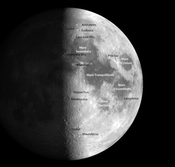 "The day-night line or terminator cuts across a magnificent landscape rich with craters and mountain ranges emerging from the lunar night. Several prominent lunar ""seas"" or maria and prominent craters are shown. Credit: Christian Legrand and Patrick Chevalley / Virtual Moon Atlas"