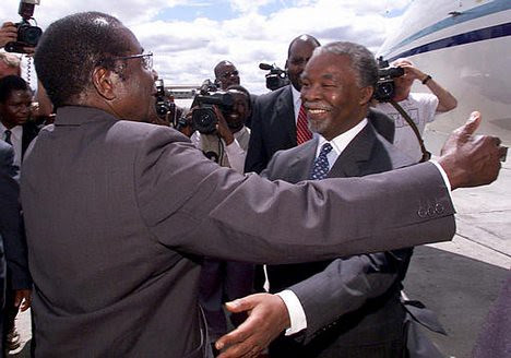 Zimbabwe President Robert Mugabe greeting former South African President Thabo Mbeki. The two leaders are working on a unity government plan for Zimbabwe. by Pan-African News Wire File Photos